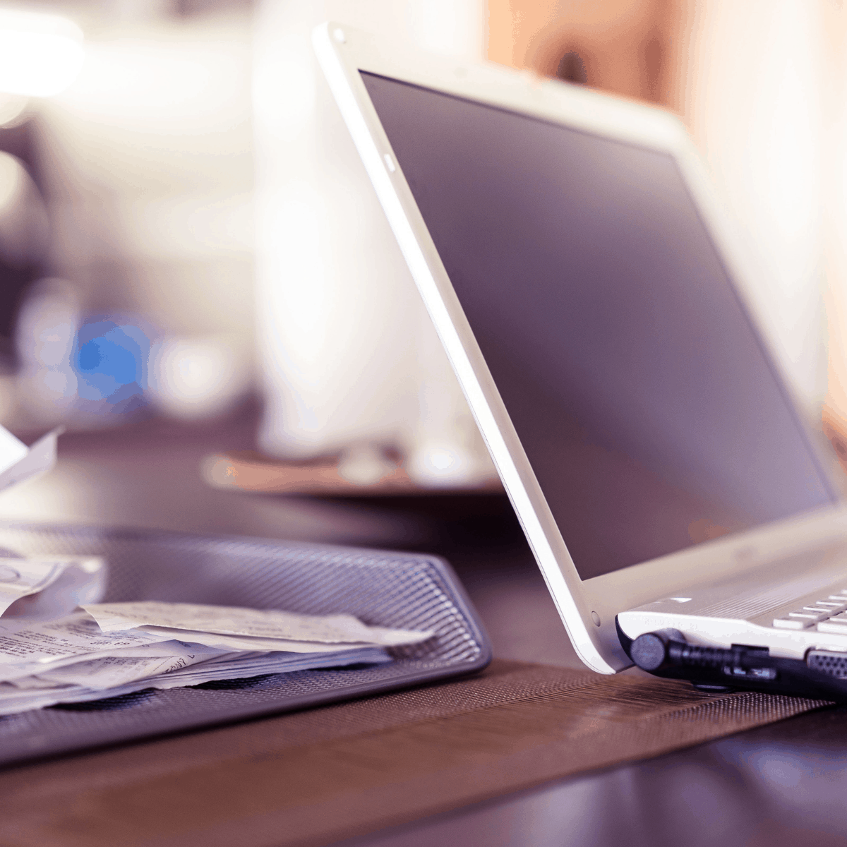 business receipts and laptop